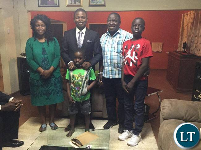 The Kalabas pose for a photo with Prophet Bushiri at their residence in Lusaka