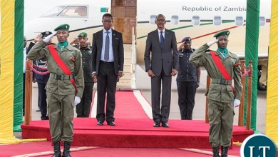 The Presidents observe the national anthem at the airport as the Zambian leader began his two-day state visit to Rwanda yesterday. (Village Urugwiro)