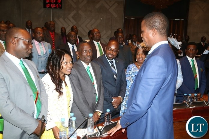 Minister of Gender Victoria Kalima confers with His Excellency President Edgar Lungu whilst other Ministers looks on shortly after State of the Nation address at Parliament Buildings