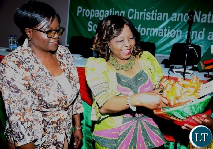 Minister of National Guidance and Religious Affairs Godfridah Sumaili cutting the ribbon whilst Permanent Secretary in the Ministry Katongo Chifwepa looking on during the Launch of it's 2018-2021 Strategic Plan at Mulungushi International Conference Centre yesterday 25-04-2018. Picture by ROYD SIBAJENE/ZANIS