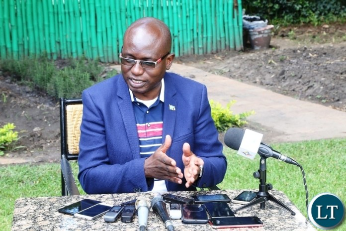 Special Assistant for Press and Public Relations to the President Amos Chanda speaking to journalists on the conduct of the Cuban Ambassador to Zambia Nelson Pages Vilas at the media briefing at Pamodzi Hotel