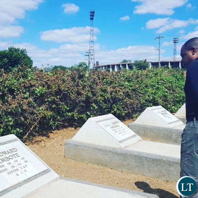 Kalusha Bwalya paying his respects to his fallen colleagues at Heroes Stadium