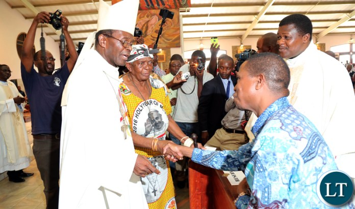 President Edgar Lungu greets Bishop Mpundu Mother in Church