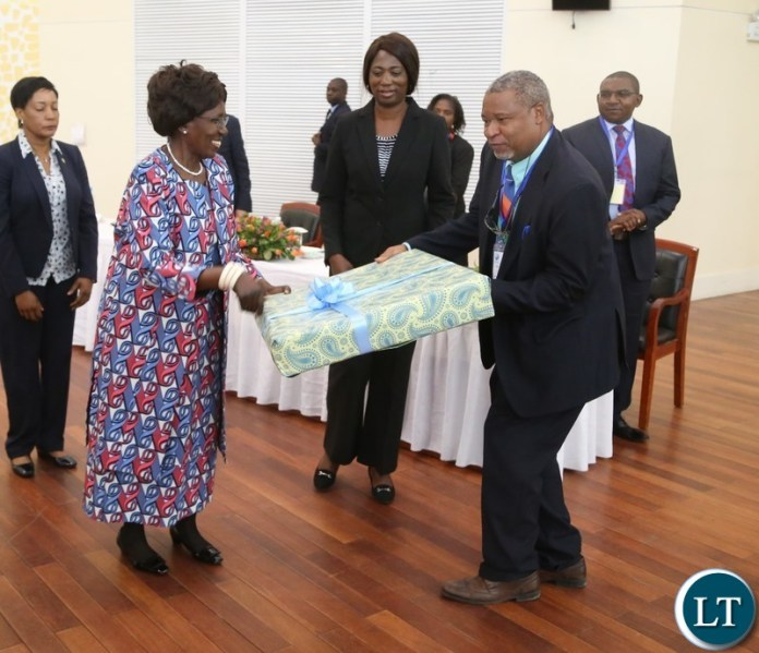 Vice President Inonge Wina receive the present from  Chairperson of Zambia Water Forum and Exhibition (ZAWAFE) Prof. Imasiku Nyambe shortly after the official opening of  Zambia Water Forum and Exhibition at Government Complex yesterday 11-06-2018. Picture by ROYD SIBAJENE/ZANIS