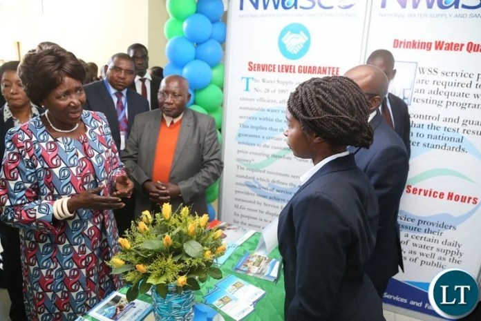 Vice President Inonge Wina confers with Zambia Water Forum and Exhibition (ZAWAFE) Exhibitors during the tour of stands shortly after the official opening of  Zambia Water Forum and Exhibition at Government Complex yesterday 11-06-2018. Picture by ROYD SIBAJENE/ZANIS