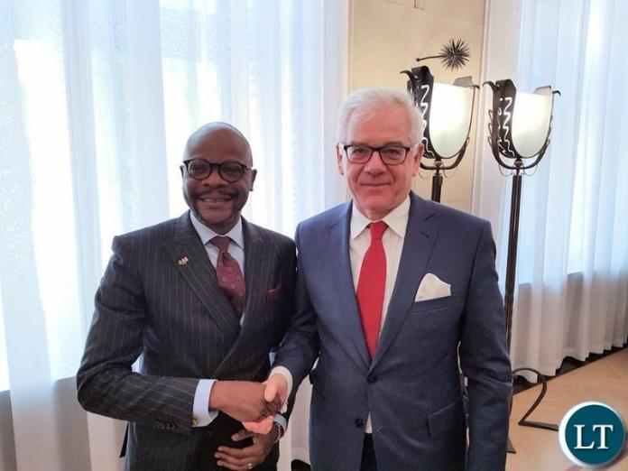 Ambassador Anthony Mukwita shares a moment with Mr Czapatowicz, Foreign Affairs Minister of Poland.