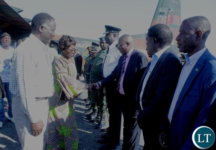 Western Province Minister Richard Kapita (L) introducing government officials (R) to Vice President Inonge Wina (C) upon Arrival at Mongu Airport  for ground breaking ceremony of a Modern Clinic in Lealui Ward and Inspect progress on the Cashew Infrastructure Development Project (CIDP) in Mongu District, Western Province.