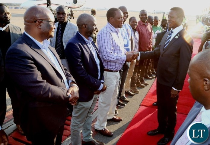 Newly Lusaka Mayoral elect Miles Sampa welcomes President Edgar Lungu shortly after his arrival from South Africa at Kenneth Kaunda International Airport