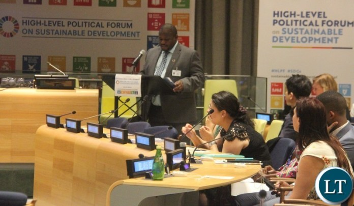 "Minister of National Development Planning, Honourable Alexander Chiteme addressing Member States at the ongoing United Nations (UN) High Level Political Forum (HLPF) on Sustainable Development themed: ""Transformation towards sustainable and resilient societies."" Picture courtesy of Zambia Mission/WALLEN SIMWAKA"