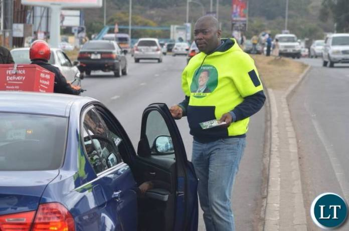 Lusaka Province Minister Bowman Lusambo interacts with motorists along the Great East Road as he campaigns for Miles Sampa