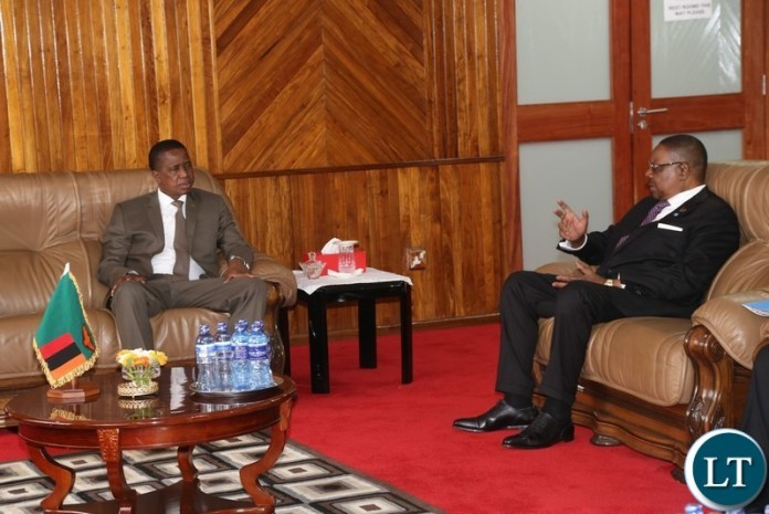 President Edgar Lungu confers with his Malawian counterpart Professor Peter Mutharika  before the official opening the 20th Summit of the Comesa Heads of State and Government in Lusaka