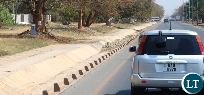 Installation of Speed Limit Cameras has brought sanity on same Lusaka roads. Here a motorist take precaution measure as they drive along great East road where Road Transport and Safety Agency (RTSA) has installed the cameras as a camera is seen on far left under the tree