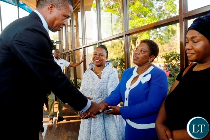 President Edgar Chagwa Lungu (left) greets Evelyn Mwanawasa, sister of the late third Republican President Levy Patrick Mwanawasa during the tenth Memorial Service at Embassy Memorial Park onSunday, August 19, 2018. PICTURE BY SALIM HENRY/STATE HOUSE ©2018