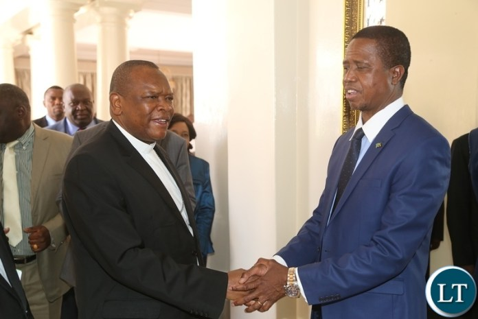 President Edgar Lungu shake hands with Vice Chair of the Conference of Catholic Bishops of Democratic Republic of Congo Bishop Fridolin Ambongo shortly meeting the President at State House