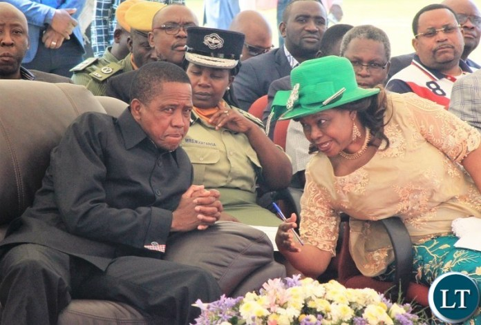 President Lungu consults Minister of Guidance and Religious Affairs Hon. Godfridah Sumaili during the 70th Anniversary of the World Council of Churches (WCC).