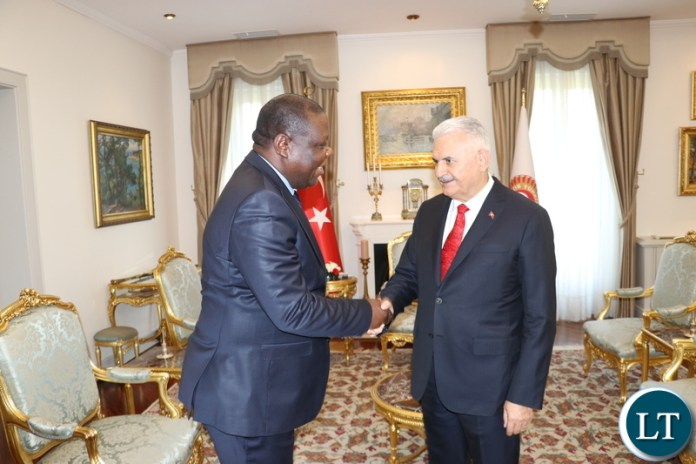 Zambia's Ambassador to the Republic of Turkey, Dr Joseph Chilengi presents a gift to Speaker of the Grand National Assembly of the Republic of Turkey, Binali Yildirim in Ankara