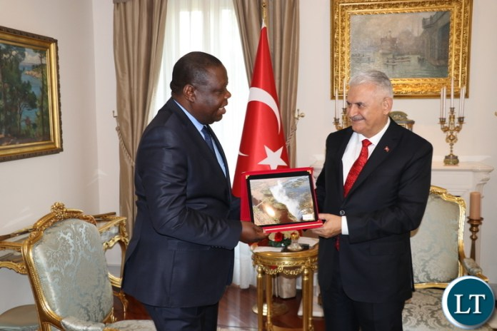 Speaker of the Grand National Assembly of the Republic of Turkey, Binali Yildirim welcomes Zambia's Ambassador to the Republic of Turkey, Dr Joseph Chilengi at his official residence in Ankara