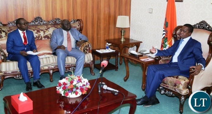President Edgar Lungu speaking to with Economics Association of Zambia president Dr. Lubinda Habazooka and Vice President Dr. Austin Mwange during the meeting at State House