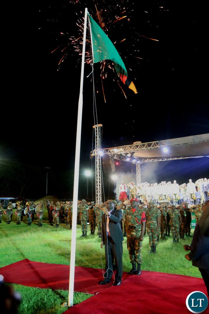 Minister of Defence Davies Chama Hoisting the Zambian Flag at Lusaka Show Grounds during the hoisting of the flag ceremony