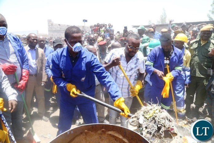 President Edgar Lungu joins in the cleaning exercise in Kafue