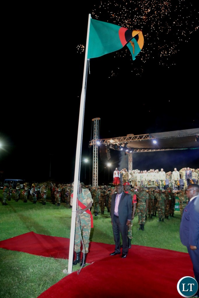Minister of Defence Davies Chama observe the moment silent shortly after Hoisting the Zambian Flag at Lusaka Show Grounds during the hoisting of the flag ceremony