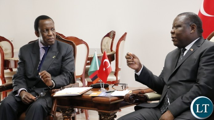 Zambia's Ambassador to the Republic of Turkey, Dr Joseph Chilengi confers with Electoral Commission of Zambia chairperson Honourable Justice Esau Chulu at the Zambian Chancery in Ankara