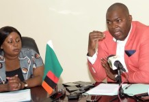 Lusaka Province Minister , Bowman Lusambo with his acting Lusaka Province Permanent Secretary, Edith Muwana during a press briefing at his office