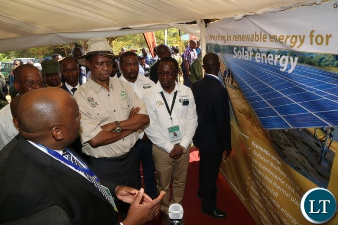 President Edgar Lungu tours Coperbelt Enegy stand during the tour of stands before the official opening of the Central Province Investment Forum and Expo in Kapiri District