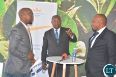 Head of legal,Mdu Lokotfwako(left) at the media briefing on manufacturing factory company which has invested over $ 25 million in construction at the Multi Facility Economic Zone in Lusaka.Looking on is Head of operations,Jerry Chivambo(m). Director British American Tobacco,Godfrey Machanzi(r)