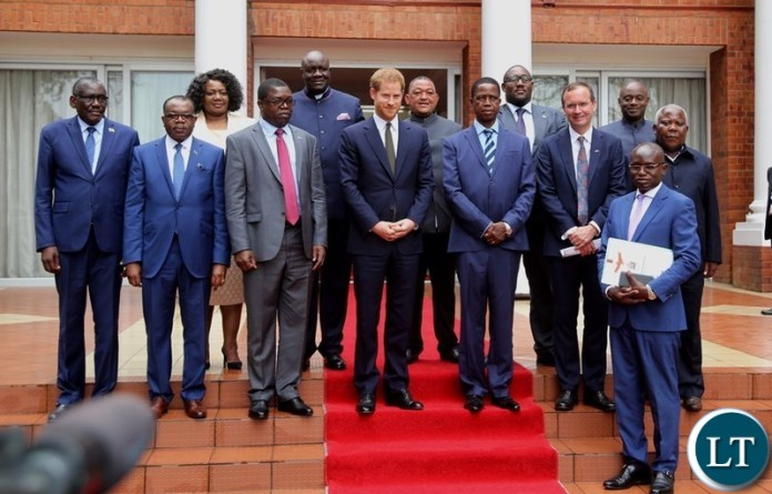 FILE: Mr. Vildan Findlayi standing between President Edgar Lungu and Prince Harry the Duke of Sussex shortly after the official talks at State House