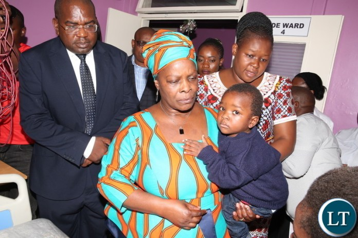 First Lady Esther Lungu on Tuesday, December 25,2018, visited the three year old boy who had 44 needles and wires embedded in his body. The boy was recently evacuated from Chipata Central Hospital to the University Teaching Hospital (UTH) following a directive by President Edgar Lungu-Pictures by THOMAS NSAMA