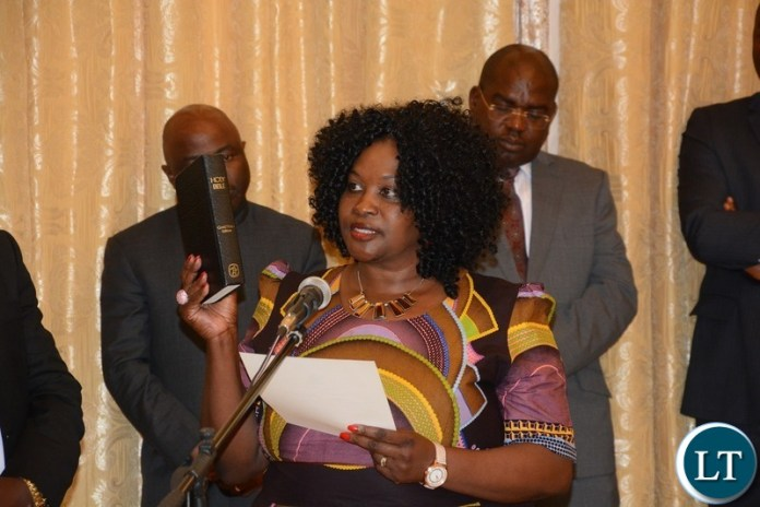 Newly Appointed Permanent Secretary Muchinga Joyce Nsamba taking oath before President Edgar Lungu during swearing in ceremony at State House