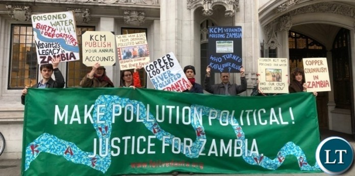 Environmental activists from Foil Vedanta hold a banner outside the Supreme Court in London, demanding justice for pollution by a British copper mining company in Zambia Photo-Samarendra Das-Foil Vedanta