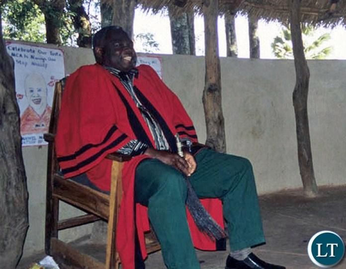 Mwanachingwala with a Fly Whisk