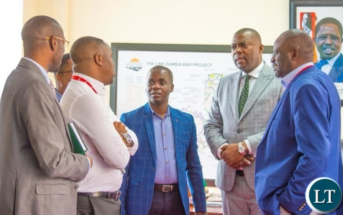 Lusaka Province Minister Bowman Lusambo meeting mobile money both operators in his office