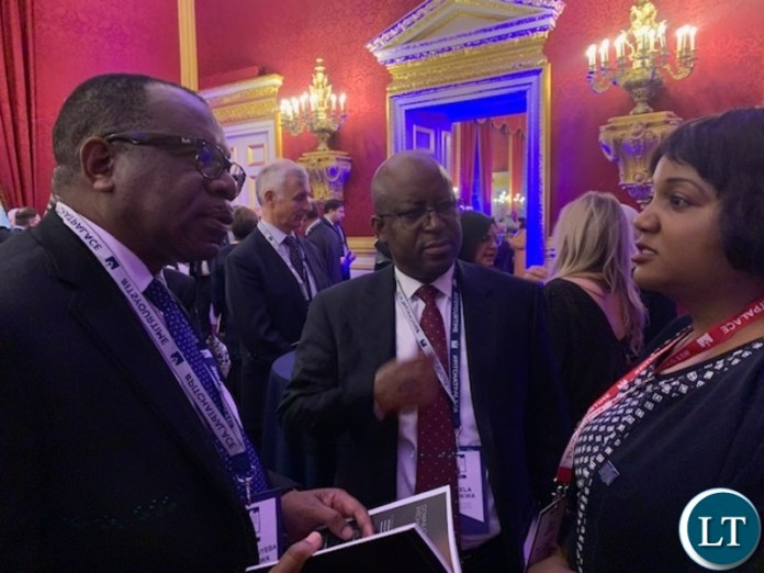 Zambia's High Commissioner to the United Kingdom His Excellency Mr. Muyeba Chikonde and Counselor Economic Mr. Mukela Mutukwa with Muzalema Mwanza at St James's Palace