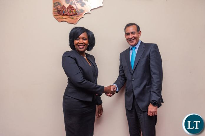 Mukwandi Chibesakunda, CEO of Natsave (left) and Raghu Malhotra, President of Middle East and Africa at Mastercard, celebrate the signing of the agreement