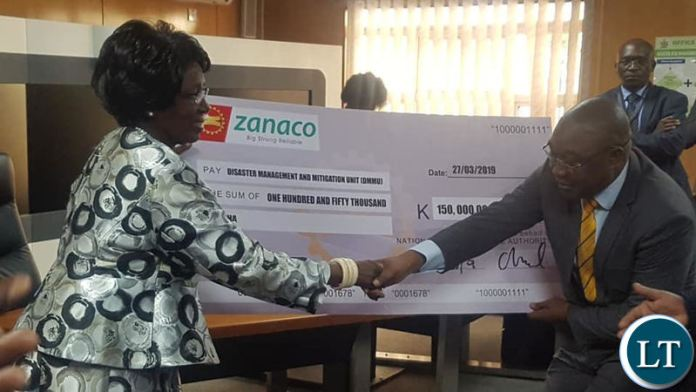 Vice President Inonge Wina receives a cheque from NAPSA Acting Director General Mr. Ronnie Kamanya