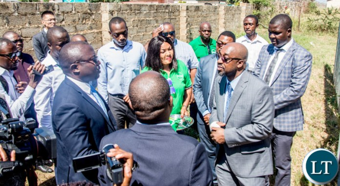 Transport and Communications Minister Dr Brian Mushimba chats with Zamtel officials during the launch of the Zamtel 4G network on mobile in Lusaka Province