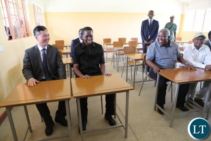 President Lungu , Chinese Ambassador to Zambia Lie Jie  and Presidential Affairs Minister Freedom Sikazwe and ZESCO Managing Director Victor Mundende in one of the classrooms for the School