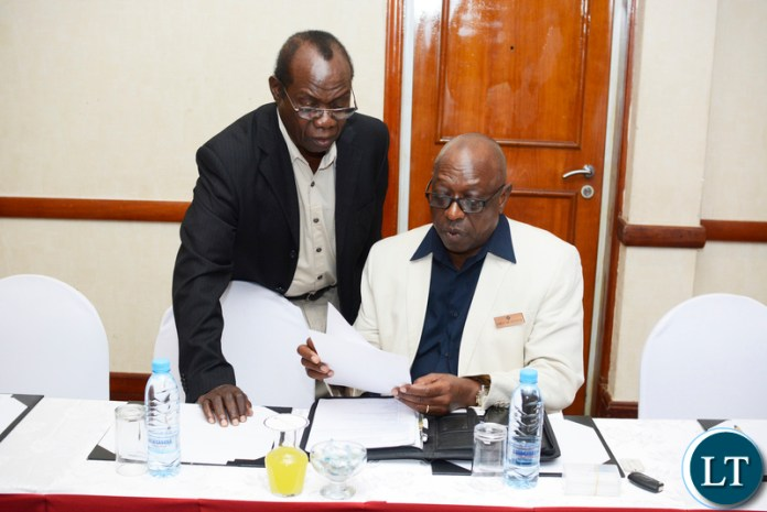 FIRST Quantum Minerals' country manager Kingsley Chinkuli (standing) compares notes with Kansanshi Mining Plc public relations manager Godfrey Msiska during the mining company's information-sharing session in Lusaka. – Picture by Andrew-Knox Kaniki/SUMA SYSTEMS.