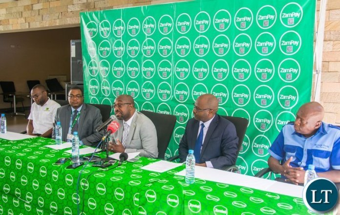 Transport and Communications Minister Brian Mushimba speaking during the launch of the ZamPay Number Neutral Capability at Zamtel House