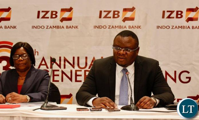 IDC Chief Executive Officer Mateyo Kaluba rearing a statement during the cheque handover ceremony