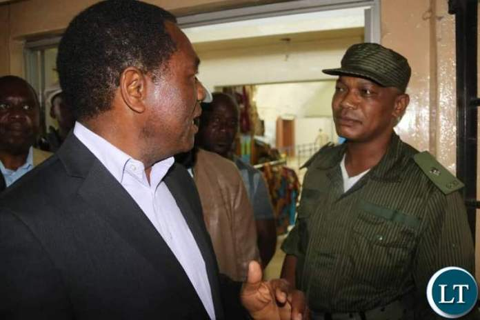 HH confronted by Police Officers at Simon Mwansa Kapwepwe