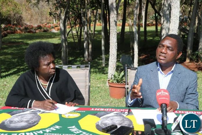Mr Hichilema speaking at a news conference at his residence as Chairperson Mutale Nalumango looks on