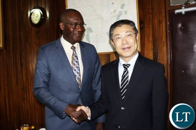 Chinese Ambassador to Zambia LI JIE with Finance Minister Bwalya Ng'andu at the Ministry of Finance headquarters in Lusaka