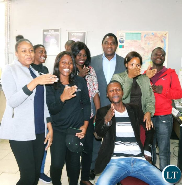 HH interacts with young people in Lusaka