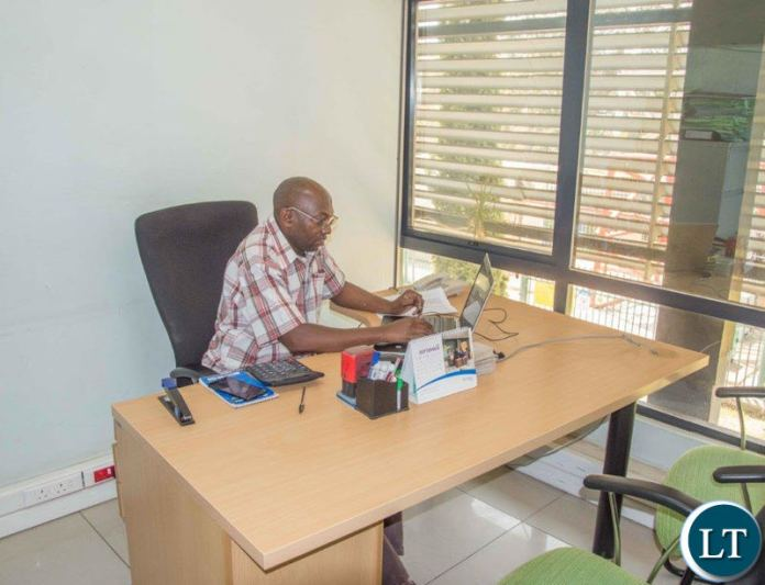 AFTER PICTURE: A Zamtel employee enjoying his work after the clean up