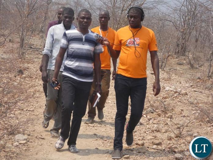 Journalist Fredinand Sianyuka from Chikuni Radio interviewing a local official during his tour of drought his areas in Pemba and Gwembe