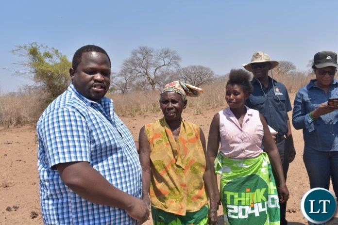 Minister Chiteme with beneficiaries of water project Kazungula